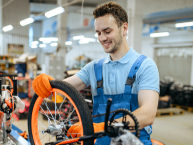 man assembling bike at factory